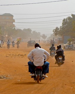 Thumb dusty road in ouagadougou burkina faso 2010